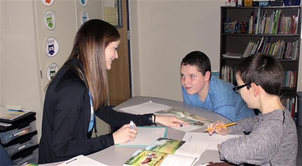 Co-teacher working with small group of students