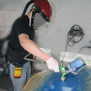 Collision Repair student painting a car hood