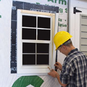 Construction Trades student installing a window