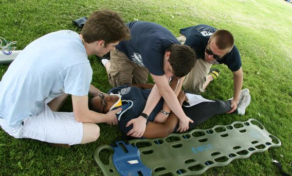 "Emergency Services students practice safely moving a volunteer ""patient"""