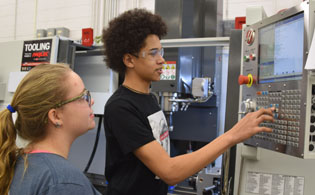 Students calibrating HAAS precision cutting machine.